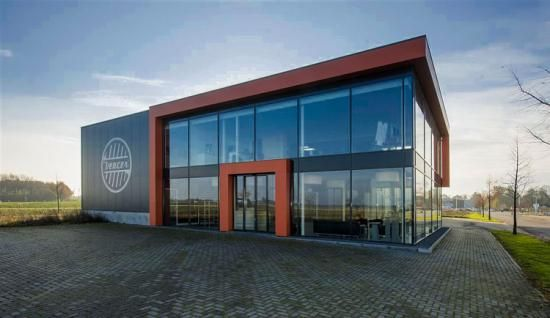 2040 OCP - Form and Character, image example of industrial building with transparent frontage and colour accent