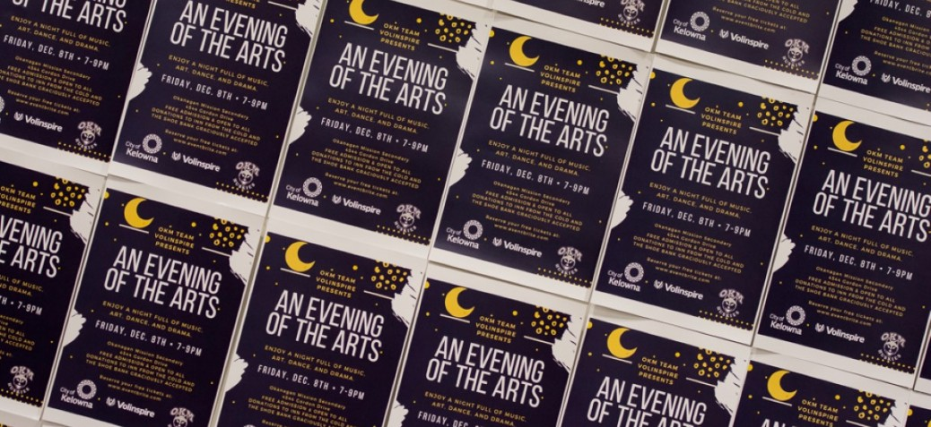 A wall of posters for evening of the arts