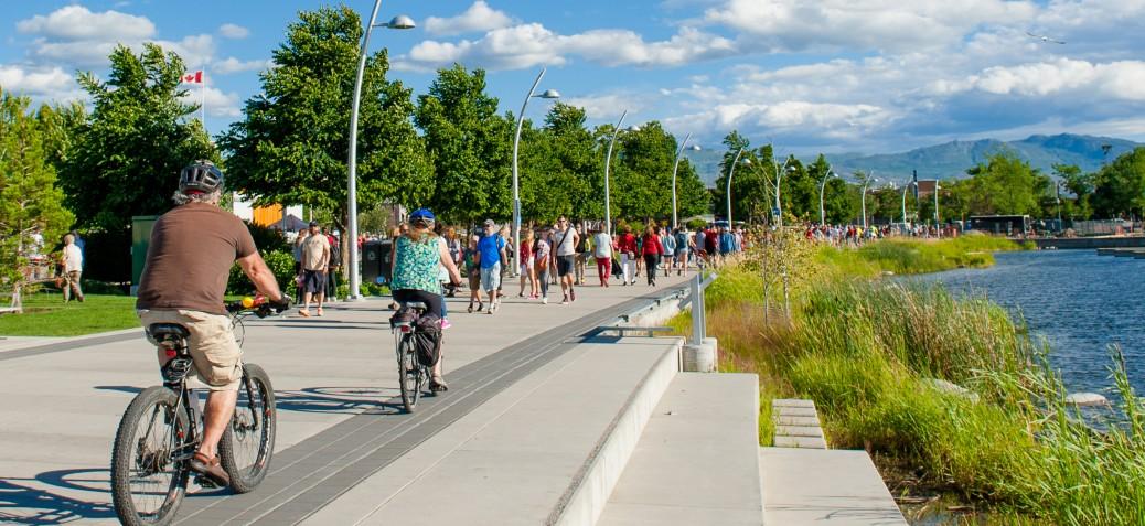 Residents walking through Stuart Park on a sunny day
