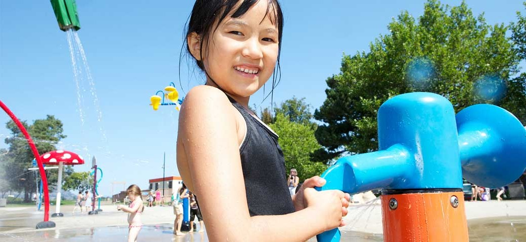 Young girl playing at City water park