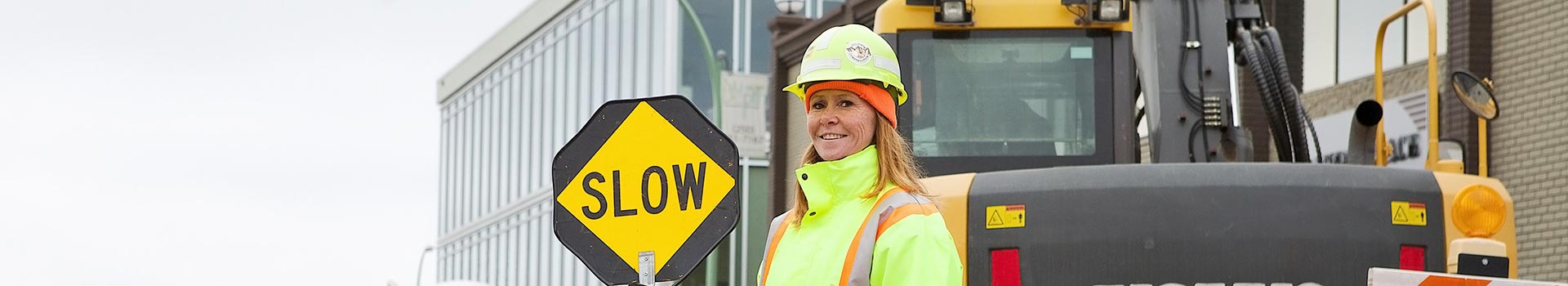 Kelowna construction flagger smiling
